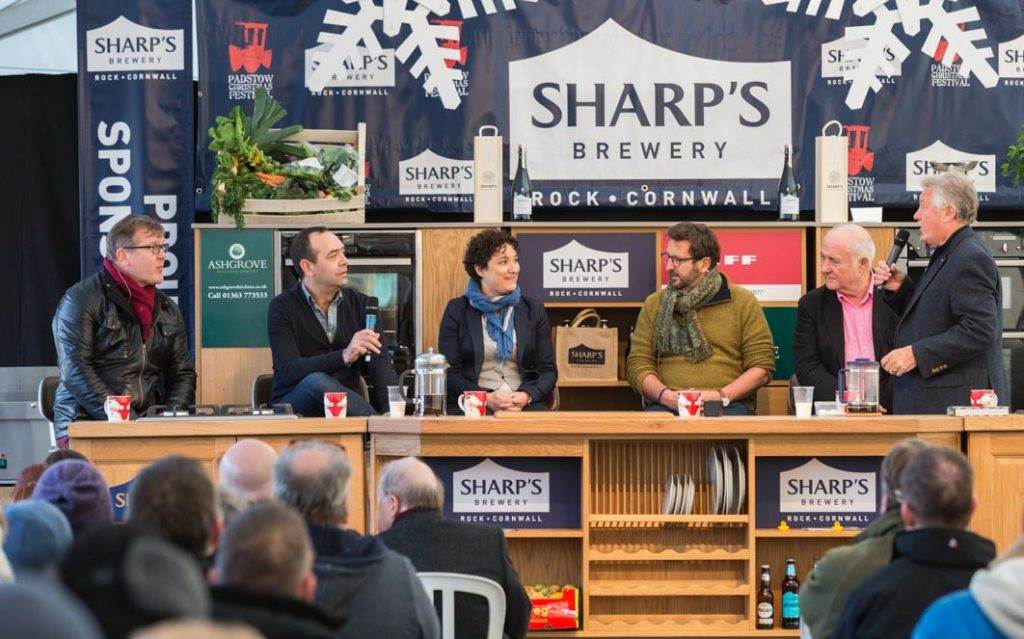 'Ask the Chef' food forum in the Sharp's Chefs Theatre at Padstow Christmas Festival 2016. Chefs from left to right: Nigel Haworth, José Pizarro, Nieves Barragán Mohacho, Mitch Tonks, Rick Stein and Brian Turner.
