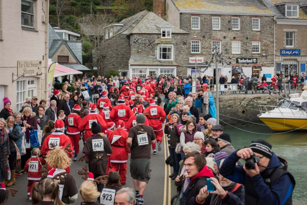 Santa and reindeer race at the Padstow Christmas Festival, raising money for Cornwall Hospice Care.